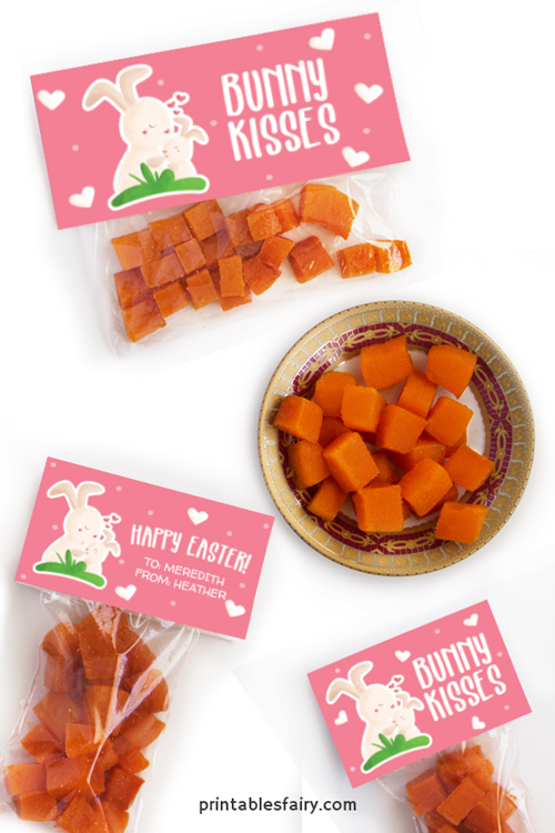 Bags of orange gummies with toppers of bunnies kissing