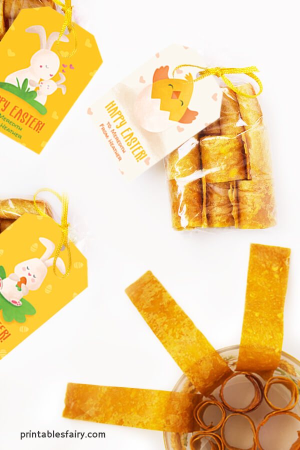 Bags of mango fruit leather with yellow Happy Easter tags