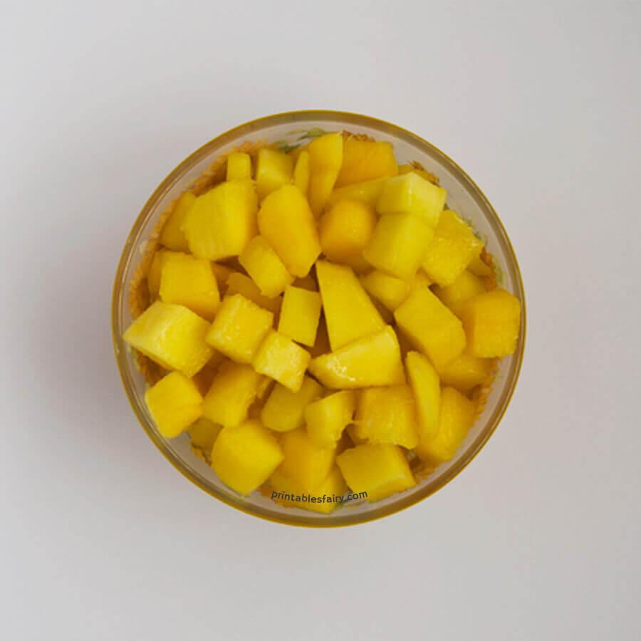 Put mango cubes into food processor