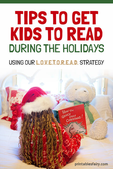 Kid with a Christmas hat reading to a teddy bear