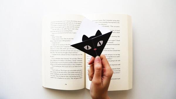 Black Cat Bookmark inside a book
