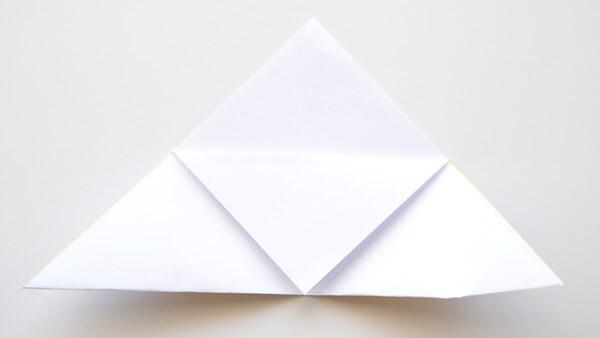 Fold top corner to the bottom