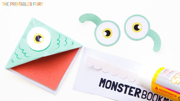 Glue eyes, mouth, and teeth