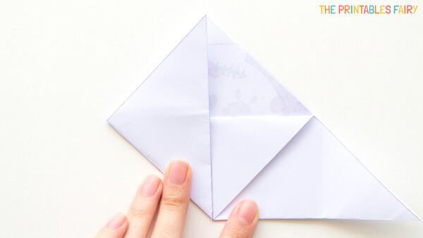 Fold left corner up