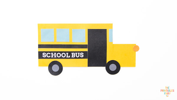 Add the small orange circle to complete your shape school bus craft