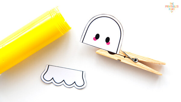Glueing the puppet to the clothespin