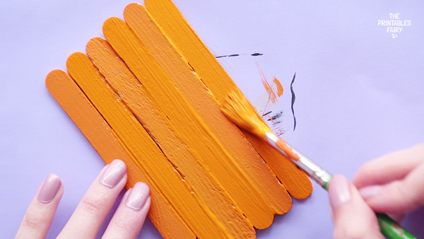 Paint the sticks orange